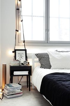 love the string lights - easy and functional, especially when there's no room for a lamp!