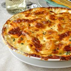 These beautiful garlic potatoes dauphinoise get additional flavour boosts from Dijon mustard and Gouda cheese! A perfect side dish with Easter ham or lamb.