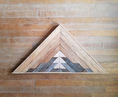 Handmade wall art made from reclaimed lath wood. This wood is salvaged from the ceiling of my art studio and has been reimagined into a geometric landscape. Made to order. Can be customized. Each piece will be unique due to the reclaimed wood. All naturally aged wood, no stain or