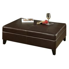 Upholstered storage ottoman with foam padding and wood frame. Product: Ottoman    Construction Material: Solid w...