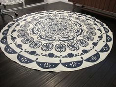 Turning A Table Cloth In To A Rug: A DIY Anthropologie Rug - Dream Book Design.  I have the perfect old tablecloth for this!!