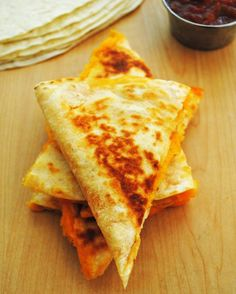 Simple and Quick Cheese Quesadillas - Three basic ingredients lurking in most kitchens and hardly 10 minutes of your time to whip up this lip-smacking Mexican treat.