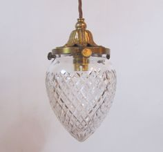 English pendant light in the original gilt brass finish complemented by period cut glass shade. c 1900  www.antiquelightingcompany.com