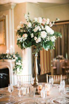 Pale pinks, peach and organic greenery wedding centerpiece: http://www.stylemepretty.com/texas-weddings/houston/2016/08/22/houston-glam-country-club-wedding/ Photography: Nancy Aidee - http://www.nancyaidee.com/