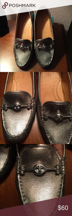 Silver Coach loafers. Coach driving loafer. Silver hardware. Great casual shoe. There is a very small discoloration on the top of the shoe. See pic #2.   However the shoe is in great shape. Shoes were purchased last month and worn  very few times. I need a wider toe box. This is why I'm letting them go.🙂🙂 Shoes Flats & Loafers