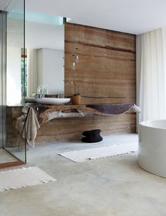 Stone wall, concrete floor, wooden table. Dream bathroom, only missing marrocan tiles.