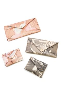Obsessing over ultra-feminine styles like these artistic wallets and clutches from Molly Virginia Campbell.