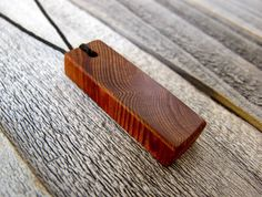 Coconut Wood Necklace Dimensions 1/4 x 3/8 x 1 1/4 (L x W x H)  - Made in Hawaii - Waxed Cord and Wooden Toggle - Buffed Urethane Finish