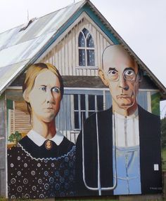 """This mural is a replica of the famous """"American Gothic"""" painting by Grant Wood, Mount Vernon, IA."""