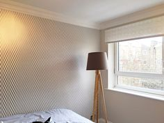 APM Finished- Guest Bedroom.  Lovely wallpaper with contrasting patterned blind and soft matching painted walls.
