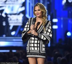 High five: Her fifth ensemble of the night included a black and white patterned dress with...