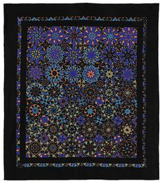 """Purple dawn quilt by Kathleen Johnson. QuiltModern/Etsy. """"Each of the 42 kaleidoscope blocks in this beautiful quilt are different, but all were made from the same fabric. Measuring 51"""" by 57"""", this quilt is a great size for a wall hanging, but can be used as a throw or a lap quilt. The backing is the fabric the blocks were made from. A hanging sleeve has been attached for ease in hanging, but can be removed if not used as a wall hanging"""