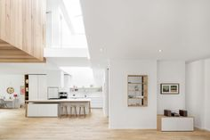 Maison Mentana by EM architecture in Montreal. White and wood kitchen.
