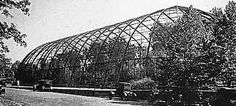 """The gigantic 228-foot long Flight Cage was built by the Smithsonian Institution to house the U. S. Bird Exhibit. Fifty feet high and 84 feet wide, it was split lengthwise into two sections by a wire mesh wall. Visitors could walk through the """"Flight Cage"""" in a 'tunnel' of wire mesh to view the birds. The city of St. Louis purchased it after the fair for $ 3,500 and this display helped provide the impetus to establish a St. Louis Zoo."""