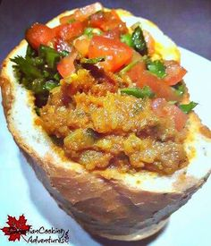 "Yes, you can have your #Curry in a bun and eat it too!! Spicy lamb (Durmas Bunny Chow) is a curry dish that was brought in the late 1800's, to South Africa by way of Indian plantation workers. The dish is called ""Bunny Chow"" and is one of the staple foods"