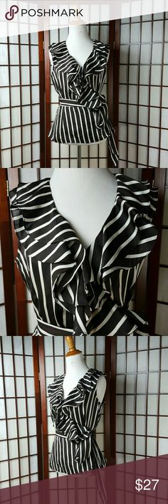 "Striped Ruffled Wrap Blouse Top Size Small Pre-owned excellent condition  LAUREN RALPH LAUREN SIZE SMALL Striped pattern Black and white colors  Cross over wrap blouse style Ruffled neckline  Made of 100% polyester  Nice top  Measurements approximate  Pit to pit 19"" Shoulder to hem 23.5"" Lauren Ralph Lauren Tops Blouses"