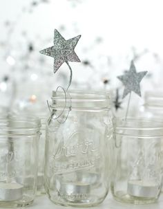 Spread that holiday cheer with this amazing idea of votive candles inside a mason jar decorated with a shining silver star.
