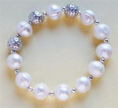 Freshwater pearl bracelet with silver golf ball beads