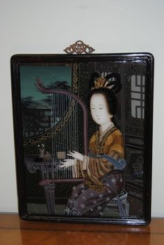 """Pair of Early 20th Century Chinese Reverse Paintings on Glass. In original frames. Measures approximately 23"""" x 17,"""" framed."""
