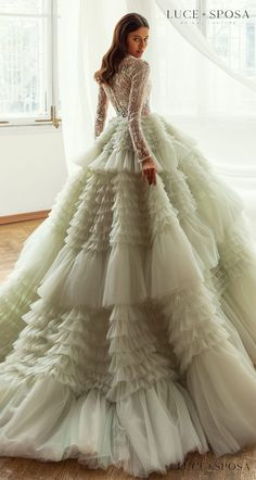 Long sleeves ball gown colored wedding dress with colorful pastel Crystal Embellishments on lace bodice and light green layered tulle skirt | Luce Sposa Wedding Dresses 2021- Abigail - Belle The Magazine #weddingdress #weddingdresses #bridalgown #bridal #bridalgowns #weddinggown #bridetobe #weddings #bride #dreamdress #bridalcollection #bridaldress #dress See more gorgeous bridal gowns by clicking on the photo