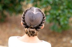 Create a heart-shaped design by mapping out a heart-shaped part first with a fine-toothed comb,and then rope braiding the rest of your hair. Don't know how to rope braid? Learn how to here. CuteGirlsHairstyles -Cosmopolitan.com