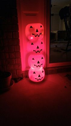 Plastic pumpkin pail lighted topiary craft. Super easy and cheap! Cut a hole in the bottoms of 3 pumpkins. And a hole in the back of one. Run Christmas lights through the holes (plug in out the back of the bottom). I used red lights. Hot glue pumpkins together.