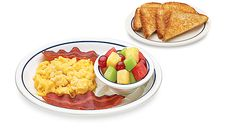 A healthy meal of scrambled egg substitute, two strips of turkey bacon, whole wheat toast and seasonal mixed fruit from the SIMPLE & FIT men...