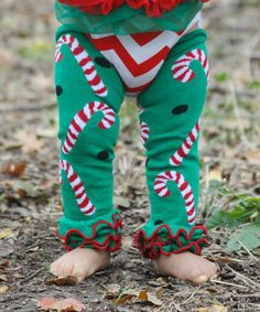 This Green & Red Candy Cane Leg Warmers - Toddler by Diva Daze is perfect! #zulilyfinds