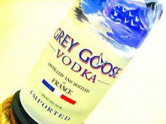3 parts GREY GOOSE® L'Orange Flavored Vodka 1/2 part Cointreau® 1/2 part cranberry juice squeeze of 1/2 lime orange twist for garnish