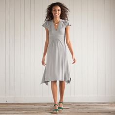 "COOL WAVE DRESS by Carve Designs -- A warm weather dress that keeps you cool from workday to weekend. Soft jersey with flutter sleeves and slimming stripes in all directions. Fitted bodice, empire waist, asymmetric hem. Organic cotton/rayon/spandex. Machine wash. Imported. Sizes XS (0 to 2), S (4 to 6), M (8), L (10 to 12), XL (14). Approx. 40-1/4""L."