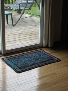 Stained Glass Crocheted Rag Rug - Your custom Colors. $80.00, via Etsy.
