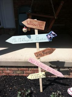 Story book baby shower themes...like the sign but not any more good ideas in blog