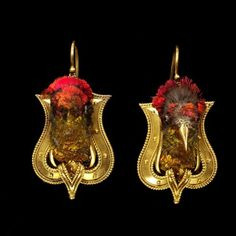 These 1865 earrings feature actual hummingbird heads with gold-covered beaks......odd