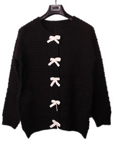 I could totally just buy a black sweater and sew bows on it! Cute and warm!! Win, win