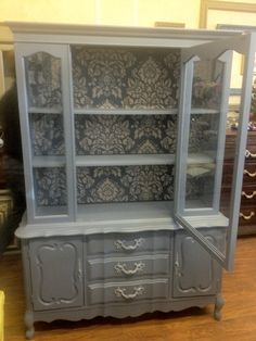 This China cabinet painted with Chalk Paint® in color Old Violet, stenciled with Paloma, Clear Waxed. Custom Painted by TLC Design Studio