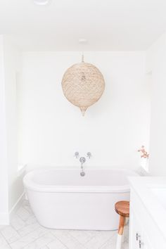 White master bathroom featuring freestanding tub, wall mounted bath faucets, herringbone marble floors, and a vintage rug. Designed and styled by Sarah Fultz Interiors. Herringbone Marble Floor, Wall Mount Tub Faucet, Bohemian Interior, Bohemian Design, White Master Bathroom, Bohemian Bathroom, Modern Farmhouse Design, Minimalist Bathroom, Dream Bathrooms