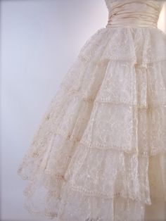 Skirt details of a Vintage 1950's Tiered Tambour Lace Wedding Dress.  Matching Bolero.