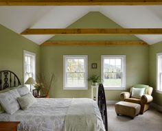 I find this fetching green bedroom appealing for the mix of bold and soft color as well as the charming furniture and accessories. The green walls really help the wood beams stand out, but the remainder of the palette remains light and soothing. It's a relaxed, airy room that I think would appeal to many — perfect for a guest room.