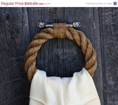 Rugged touch from this nautical rope towel bar!!! Bebe'!!! Cute for a beach house bath or kitchen!!!