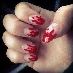 Dipped in blood. | 27 Delightfully Spooky Ideas For Halloween Nail Art