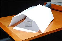 Mini Macro Studio for Less than $0.02  Another useful tutorial on building a mini-macro studio out of everyday objects in no time. The set-up is very simple and requires only a sheet of paper, folded and taped. It is very easy to make and produces nice results.