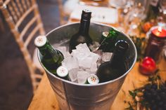 Ice cold drink to keep your guests happy during the meal. The metal buckets also fed into the industrial theme at this wedding by Glass Slipper Weddings.