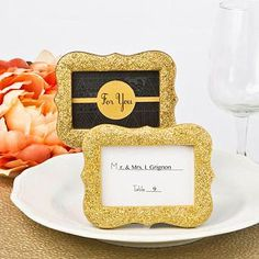 For your 50th anniversary banquet tables use these gold glitter place card frames. As low as $2.19 each