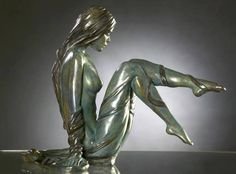 Poised in a sculpture .. By Sculptor Marie-Paule Deville Chalrolle