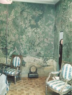 Pauline de Rothschild in her Paris apartment bedroom, decorated in 18th century chinoiserie wallpaper. I've always loved this photo