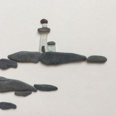 Pebble Art by Sharon Nowlan, sea glass lighthouse pebble art comes matted or framed in 12 by 12 frame. Stone Pictures Pebble Art, Stone Art, Sea Glass Crafts, Sea Glass Art, Glass Beach, Stained Glass, Stone Crafts, Rock Crafts, Beach Rock Art