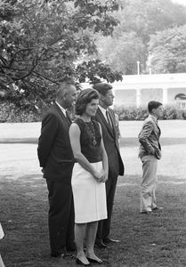 "Vice President Lyndon B. Johnson (LBJ) presents a new pony, ""Tex"" to Caroline Kennedy (CBK); children playing on the South Lawn - John F. Kennedy Presidential Library & Museum"
