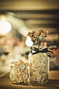 Mason jars with buttons for wedding center pieces