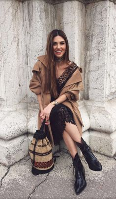 Wear a lace dress with a bunched up tan coat to... - Street Style