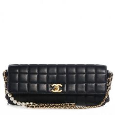 Chanel Lambskin East West Chocolate Bar Pearl Chain Flap Shoulder Bag. Get one of the hottest styles of the season! The Chanel Lambskin East West Chocolate Bar Pearl Chain Flap Shoulder Bag is a top 10 member favorite on Tradesy. Save on yours before they're sold out!